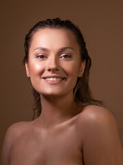 tanned, sweet girl with clear, glowing skin. Health and skin care.