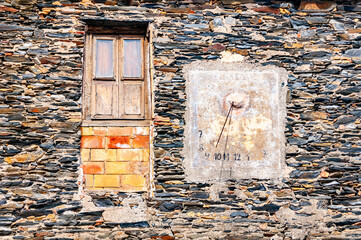Old wall. Background with door and Sun Clock in Cadaques, Spain