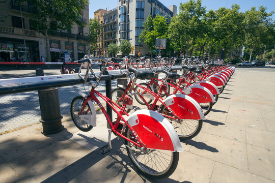 BARCELONA - MAY 21, 2016: Row of rental bikes from Vodafone Bicing is a self-service, bike-sharing scheme for short journeys.