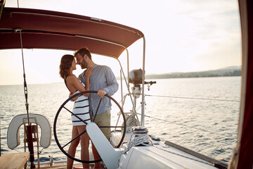 Young couple in love on a yacht