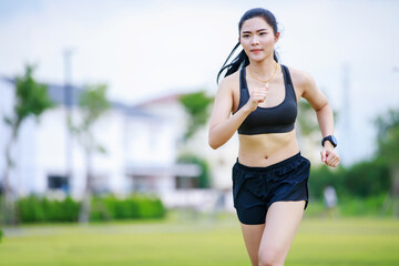 asian woman running in the village park
