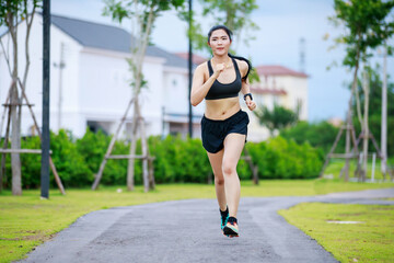asian woman running in village park