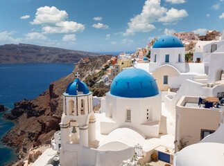 The famous three blue domes in Santorini