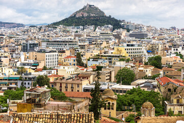Fototapete - Urban landscape of Athens, scenic view from Plaka district, Greece. Cityscape of Athens with Mount Lycabettus
