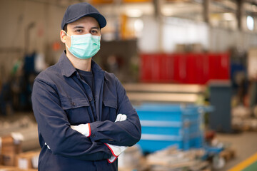 Worker in a factory wearing a mask