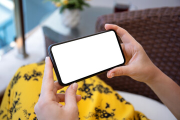 female hands in yellow dress holding phone with isolated screen