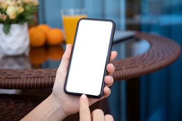 female hands holding phone with isolated screen on background cafe