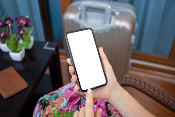 female hands holding phone with isolated screen and suitcase