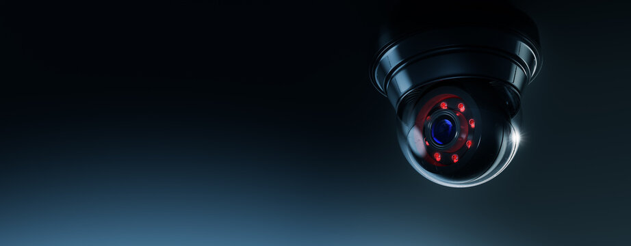 High contrast image of a surveillance camera on a dark background (3D rendering, illustration)