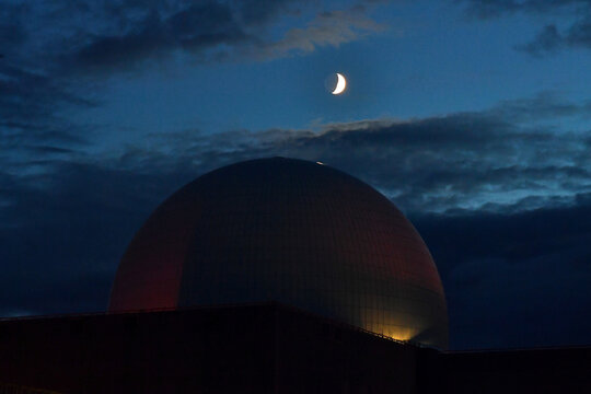 The moon is seen above Sizewell Nuclear Power Station in Sizewell