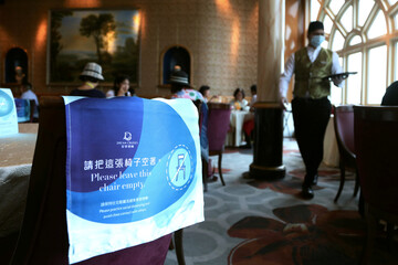 Social distancing signs are seen in the restaurant to prevent the spread of the coronavirus disease (COVID-19), on the Explorer Dream cruise ship, in Keelung
