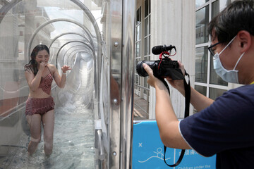 An internet show host enjoys the water slide on the Explorer Dream cruise ship in Keelung
