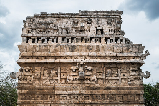 Pre-columbian carvings on the walls of one of the buildings at the Chichen-Itza Mayan site, Mexico.