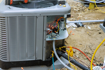 Air conditioning technician of preparing to install new air conditioner.