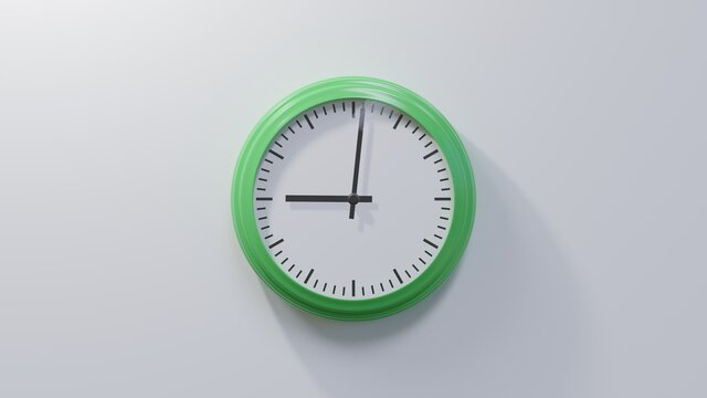 Glossy green clock on a white wall at one past nine. Time is 09:01 or 21:01