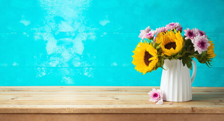 Beautifull bouquet with sunflowers on wooden table with copy space. Kitchen or home decor concept