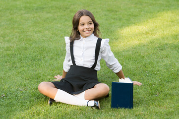 world of learner. back to school. hardworking child with book. concept of education and reading. development of the imagination. cute girl read book. happy preschool girl with book in school yard