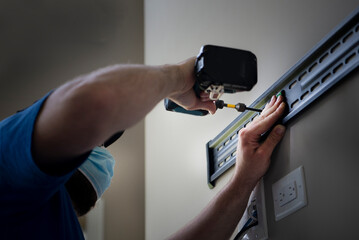 An electrician at work during COVID - small business