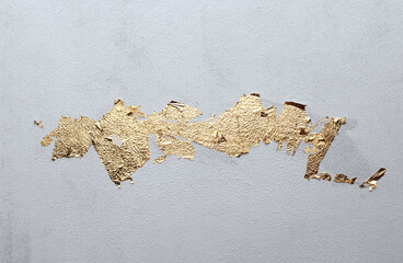 Grunge dirty texture wall with gold paper. Abstract background.
