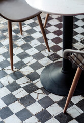 traditional design old rustic floor tiles detail in spanish cafe