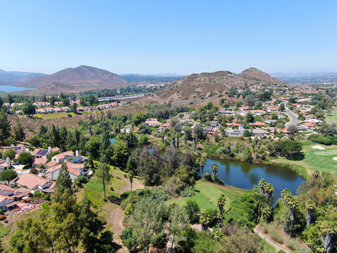 Aerial view of residential neighborhood surrounded by golf in green valley, Rancho Bernardo, San Diego County, California. USA.