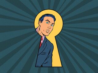 Keyhole peeping male businessman