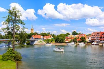 Obraz Yacht sailing on canal in Mikolajki town on sunny summer day, Mazury Lake District, Poland - fototapety do salonu