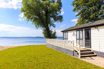 Obraz Camping house in sailing port Nowe Guty on Lake Sniardwy on summer sunny day,  Masurian Lakes, Poland - fototapety do salonu