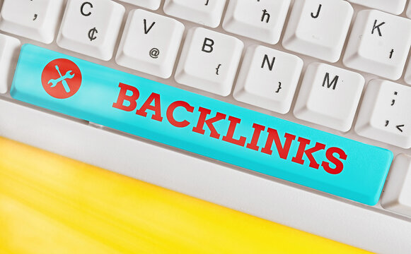Handwriting text Backlinks. Conceptual photo links from one website to a page on another website or page Different colored keyboard key with accessories arranged on empty copy space
