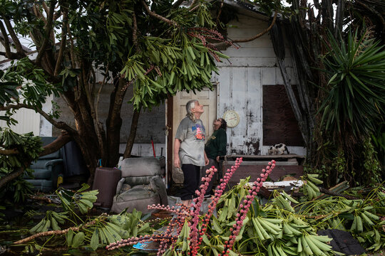 Couple survey their destroyed home in the aftermath Hurricane Hanna in Port Mansfield, Texas