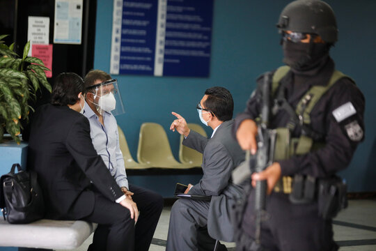 El Salvador's former Minister of Defense David Munguia Payes speaks with his lawyers at a courthouse after his detention on suspicion of unlawful association and other crimes linked to the arrangement of a 2012-2014 truce between crime gangs