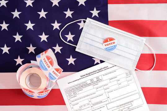 American voters must register by filling out a form even during the pandemic, wearing a face mask when voting.