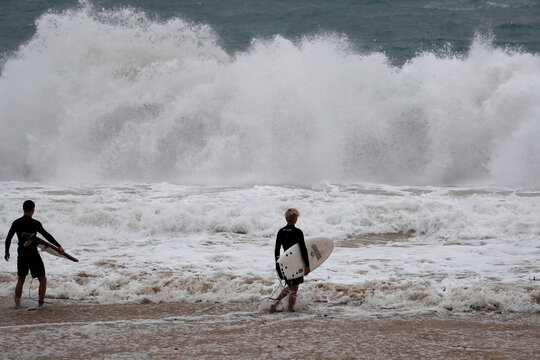 Surfers take to the waves at Pounder's Beach in Laie, Hawaii, U.S. July 26, 2020, as Hurricane Douglas makes its way towards Oahu