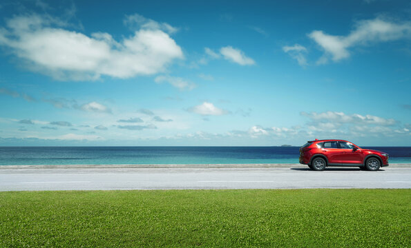 Kuala Lumpur, Malaysia - July 21, 2020 : New red Mazda CX 5 crossover SUV park at seacoast with beautiful day. Mazda CX 5 is one of Malaysian favorite SUV car .