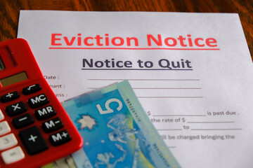 Eviction notice with Cash Canadian Dollars to pay outstanding and calculator
