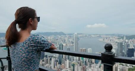 Wall Mural - Tourist woman look at the city in Hong Kong
