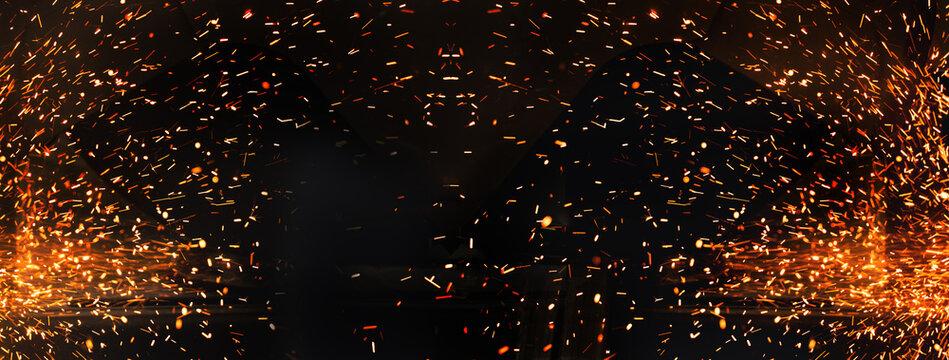 glitter spark orange light fire on black industrial or party banner background