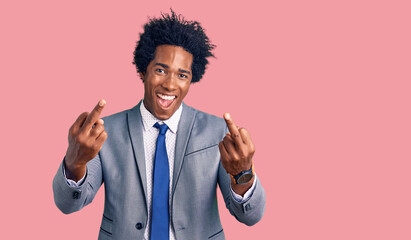 Handsome african american man with afro hair wearing business jacket showing middle finger doing fuck you bad expression, provocation and rude attitude. screaming excited