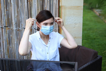 Virus protection. The woman puts on a protective mask. Prevention and protection against infection. Healthcare