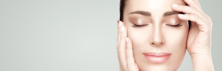 Closeup beautiful face woman with fresh clean skin. Cosmetology, beauty treatment, spa and skincare