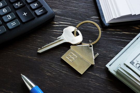 First time home buyer loan mortgage. Metal key and money.