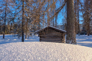 Wooden hut in deep fresh snow