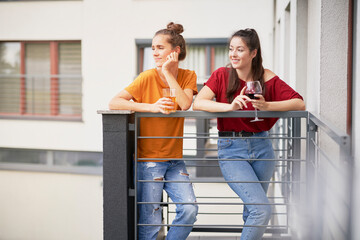 Two girls spending time relaxing on balcony
