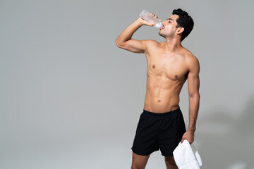 Thirsty Hispanic Male Athlete Drinking Water
