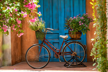 Aluminium Prints Bicycle Vintage bike with basket full of flowers next to an old building in Danang, Vietnam, close up