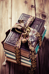 Stack of old books with vintage ribbon as present