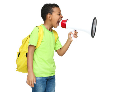 Young African American school boy screaming in megaphone with backpack on white background