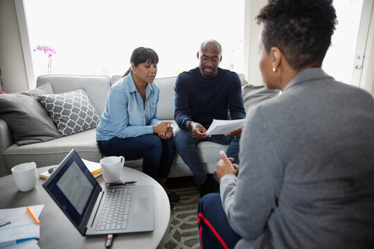 Financial advisor meeting with couple in living room