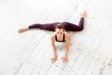 High angle of a woman doing a half frontal split