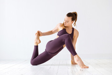 Athletic young woman doing hamstring stretches
